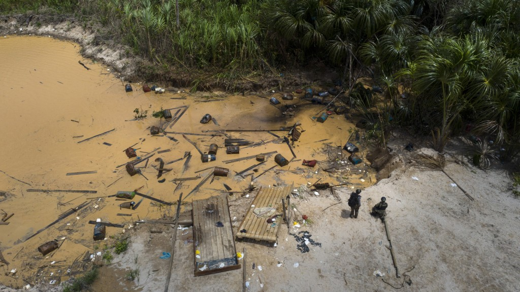 """This March 27, 2019 photo shows an illegal mining camp destroyed by members of """"Operation Mercury"""",  in Peru's Tambopata province. """"The damage to natu"""