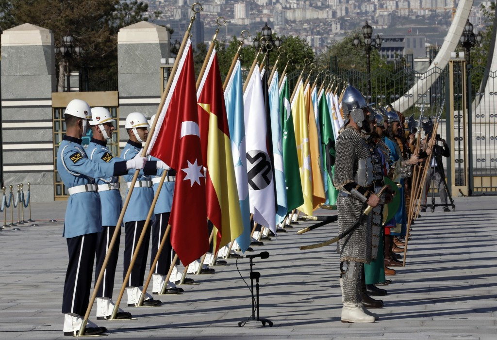 Members of military honour guard in historical costumes and holding 16 flags of old Turkish states wait for a welcome ceremony for Iraqi Prime Ministe
