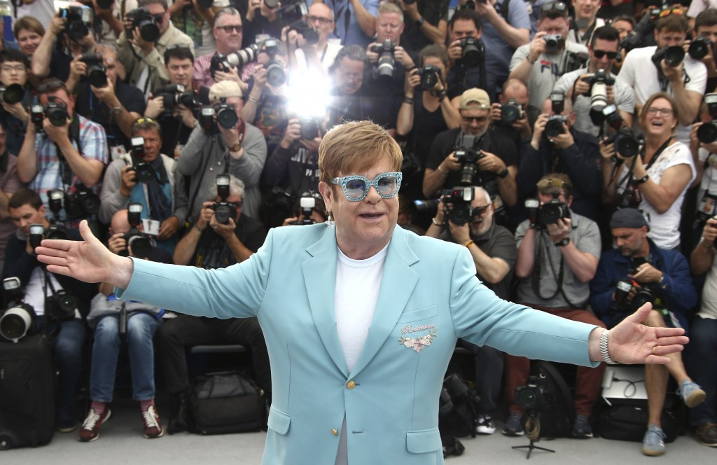 Singer Elton John poses for photographers at the photo call for the film 'Rocketman' at the 72nd international film festival, Cannes, southern France,