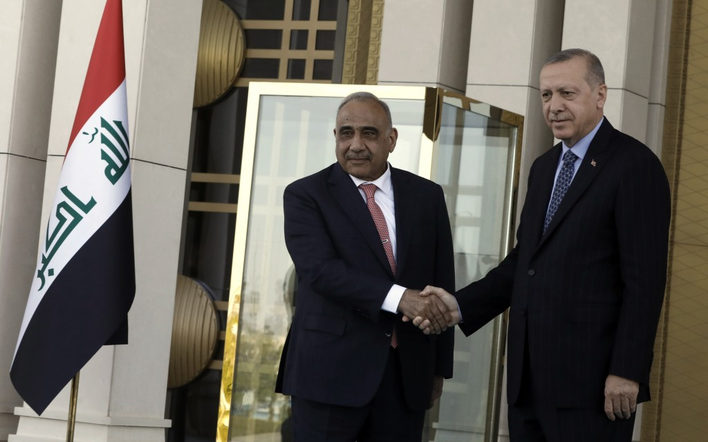 Turkish President Recep Tayyip Erdogan, right, and Iraqi Prime Minister Adel Abdul-Mahdi shake hands during a welcome ceremony, in Ankara, Turkey, Wed