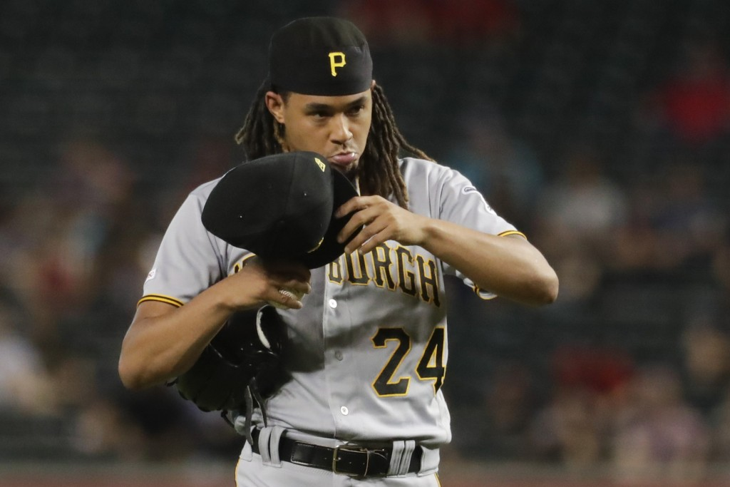 Pittsburgh Pirates starting pitcher Chris Archer walks off the mound after giving up tree run against the Arizona Diamondbacks during the top of the f