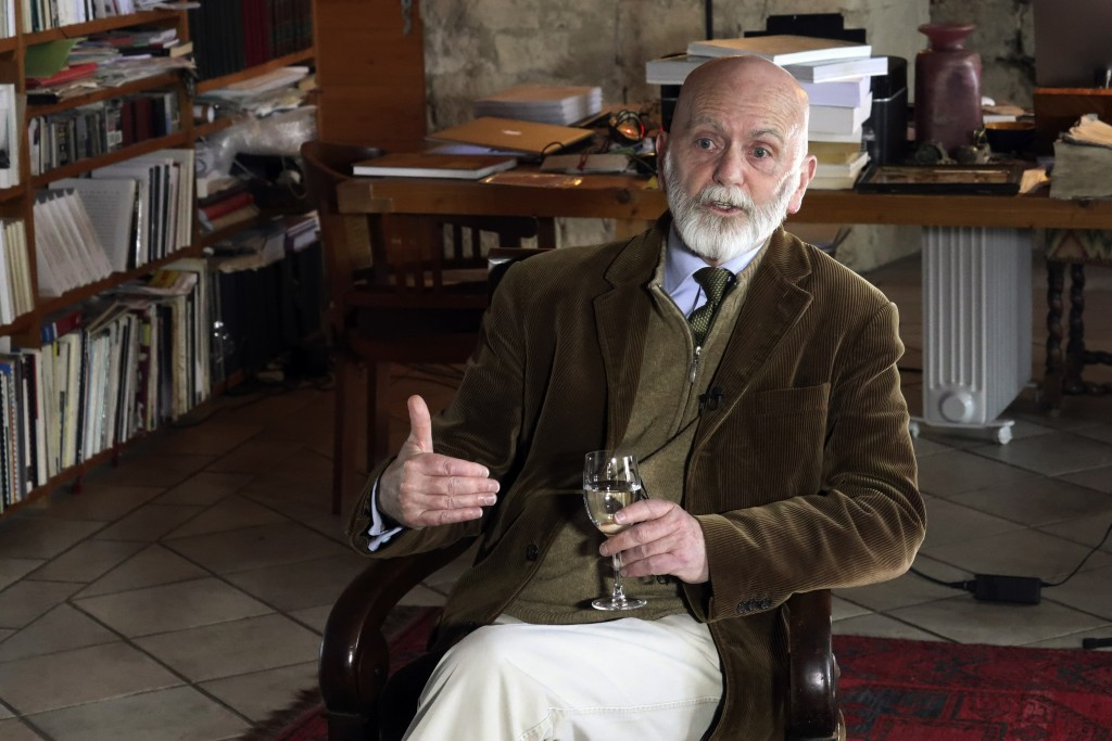 """In this April 4, 2019, photo, a candidate for Europe's legislature Renaud Camus, who coined the term, """"the great replacement,"""" sits in his house durin"""