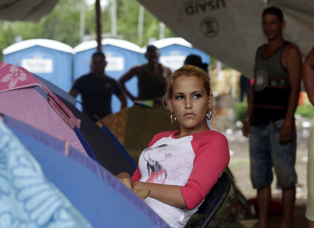 In this May 10, 2019 photo, Cuban migrant Lisandra Perez Molina, rests next to her tent at a shelter in Peñitas, Darien Province, Panama. Perez gave b