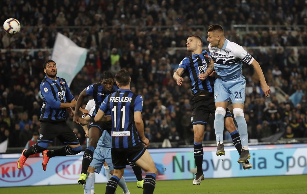 Lazio's Sergej Milinkovic Savic, right, scores his side's opening goal during the Italian Cup soccer final match between Lazio and Atalanta, at the Ro