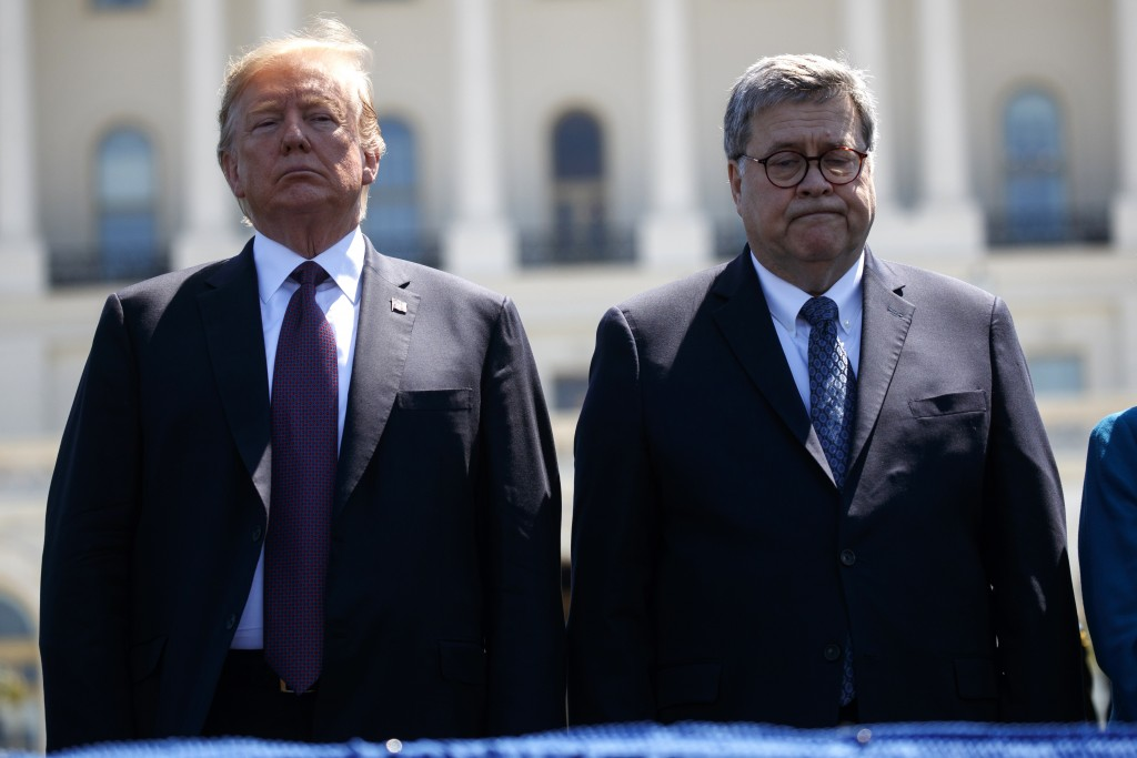 President Donald Trump stands with Attorney General William Barr during the 38th Annual National Peace Officers' Memorial Service at the U.S. Capitol,...