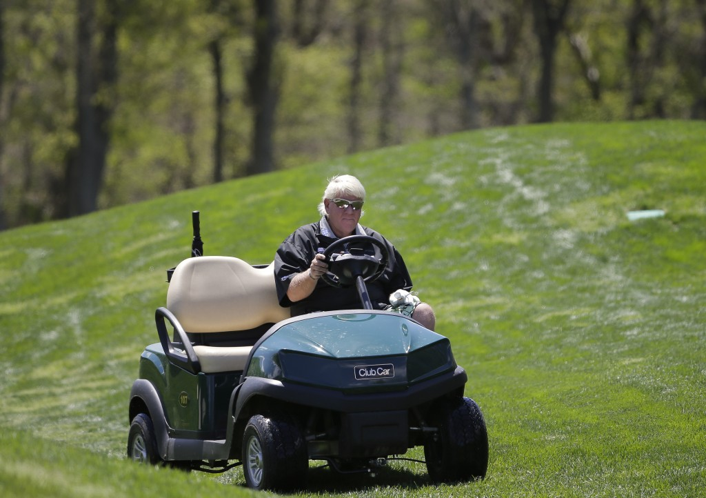 John Daly drives to the fifth green in a cart during a practice round for the PGA Championship golf tournament, Wednesday, May 15, 2019, at Bethpage B