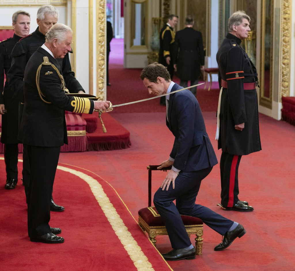 Britain's Andy Murray receives his knighthood from Prince Charles during an investiture ceremony at Buckingham Palace, London, Thursday May 16, 2019.