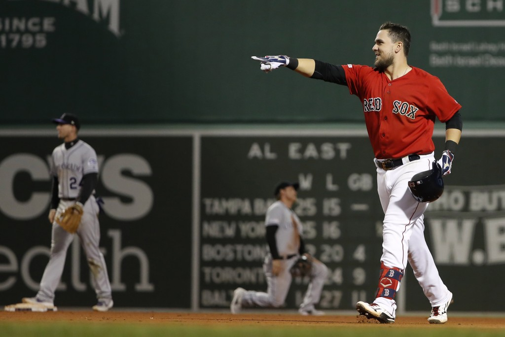 Boston Red Sox's Michael Chavis celebrates his games-ending single against the Colorado Rockies during the 10th inning of a baseball game Wednesday, M