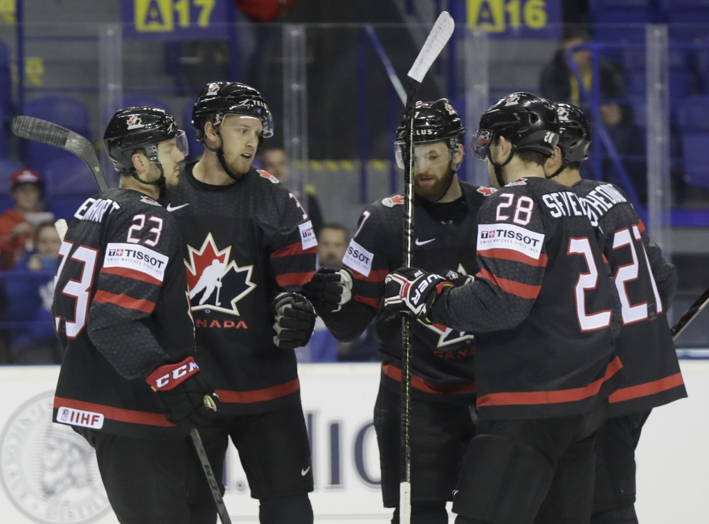 Canada's Anthony Mantha, 2nd left, celebrates with teammates after scoring his sides first goal during the Ice Hockey World Championships group A matc...