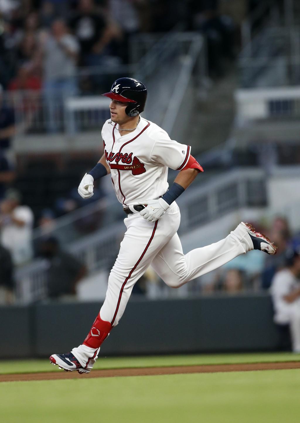Atlanta Braves' rookie Austin Riley rounds the bases after hitting a home run in the fourth inning of a baseball game against the St. Louis Cardinals ...