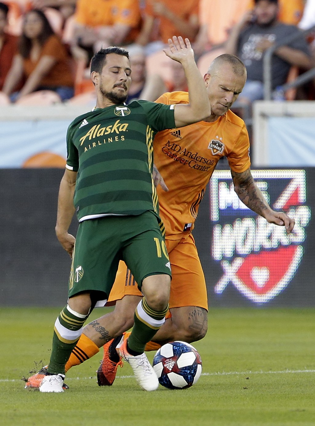 Portland Timbers midfielder Sebastian Blanco (10) falls back as Houston Dynamo defender Aljaz Struna attempts to steal the ball during the first half