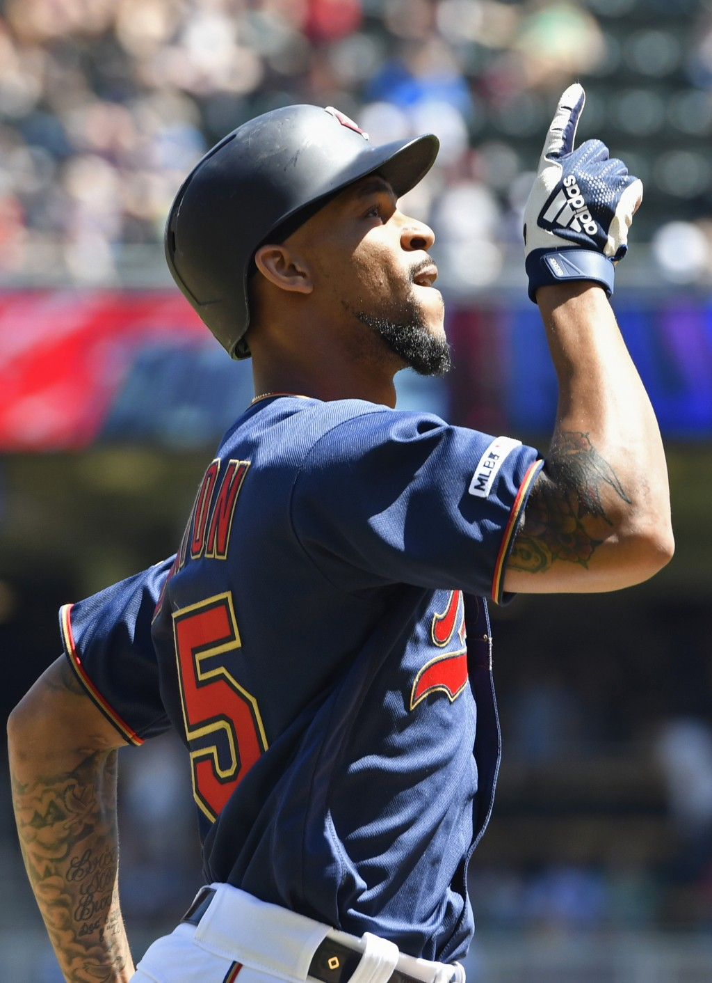 Minnesota Twins' Byron Buxton celebrates his two-run home run off Los Angeles Angels pitcher Trevor Cahill in the fifth inning of a baseball game Wedn