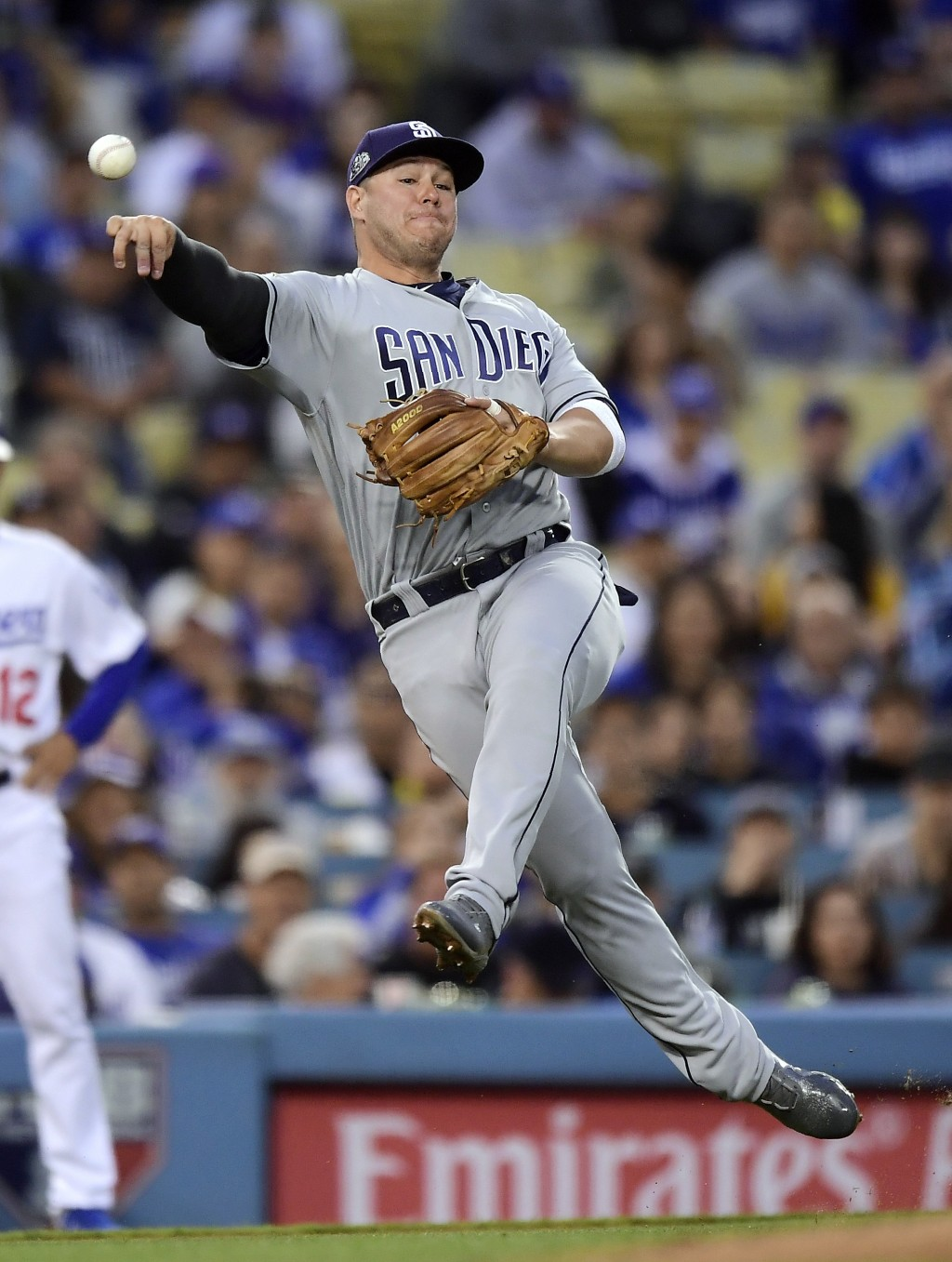 San Diego Padres third baseman Ty France attempts to throw out Los Angeles Dodgers' Corey Seager at first during the second inning of a baseball game