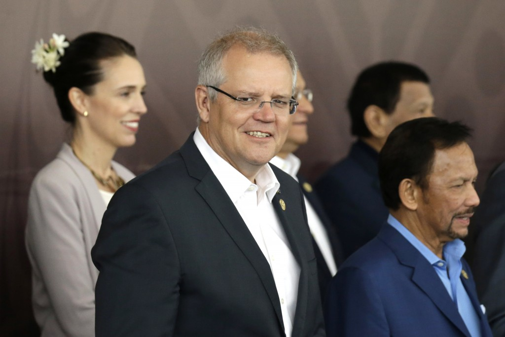 FILE - In this Nov. 18, 2019, file photo, Australia's Prime Minister Scott Morrison, center, poses for a group photo at APEC Haus in Port Moresby, Pap