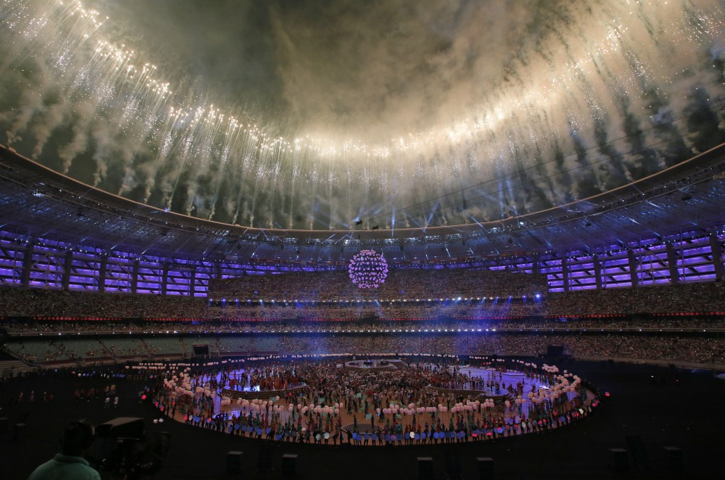 FILE - In this Sunday, June 28, 2015 file photo, fireworks explode above the Baku Olympic stadium in Baku, Azerbaijan, during the closing ceremony of