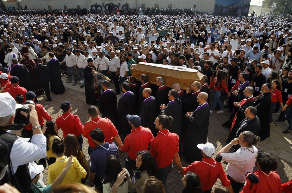 Clergymen carry the coffin of former Maronite Patriarch Cardinal Mar Nasrallah Boutros Sfeir, during his funeral Mass, at the seat of the Maronite Chu