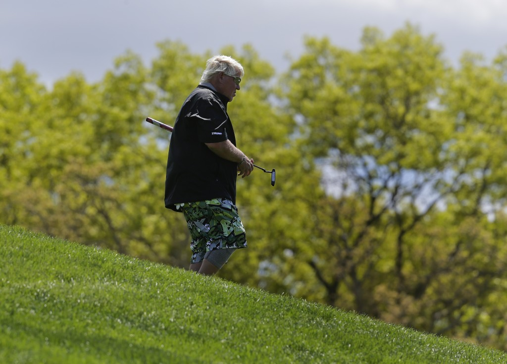 John Daly walks down to the fifth tee from the fourth green during a practice round for the PGA Championship golf tournament, Wednesday, May 15, 2019,