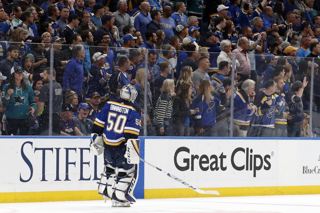 St. Louis Blues goaltender Jordan Binnington skates off the ice after the San Jose Sharks beat the Blues in overtime of Game 3 of the NHL hockey Stanl