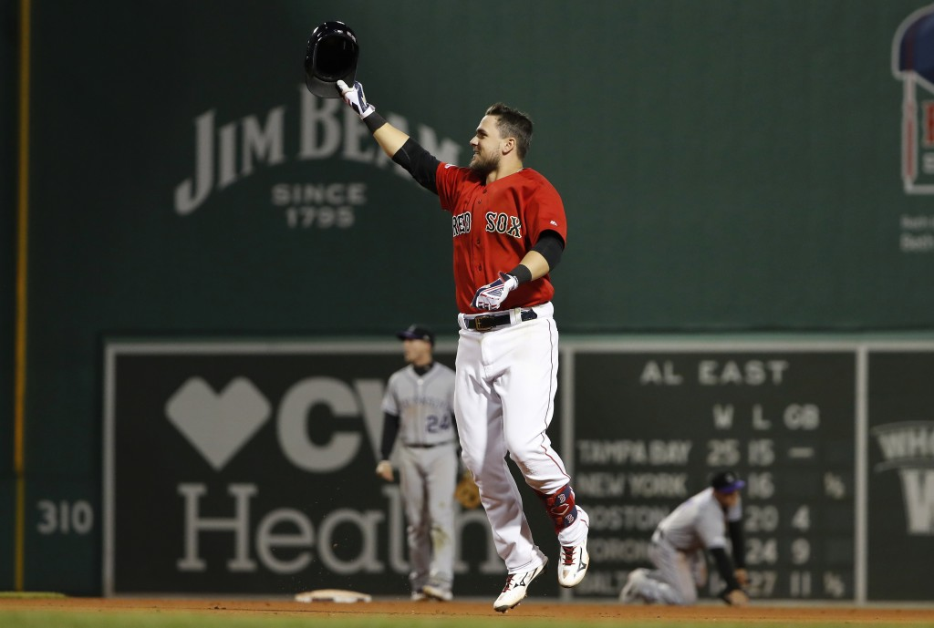 Boston Red Sox's Michael Chavis celebrates his walk-off RBI single against the Colorado Rockies during the 10th inning of a baseball game Wednesday, M