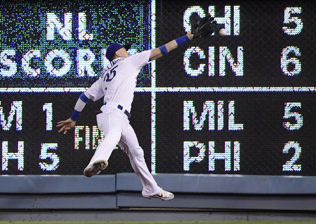 Los Angeles Dodgers right fielder Cody Bellinger can't make the catch on a double by San Diego Padres' Manny Machado during the fourth inning of a bas