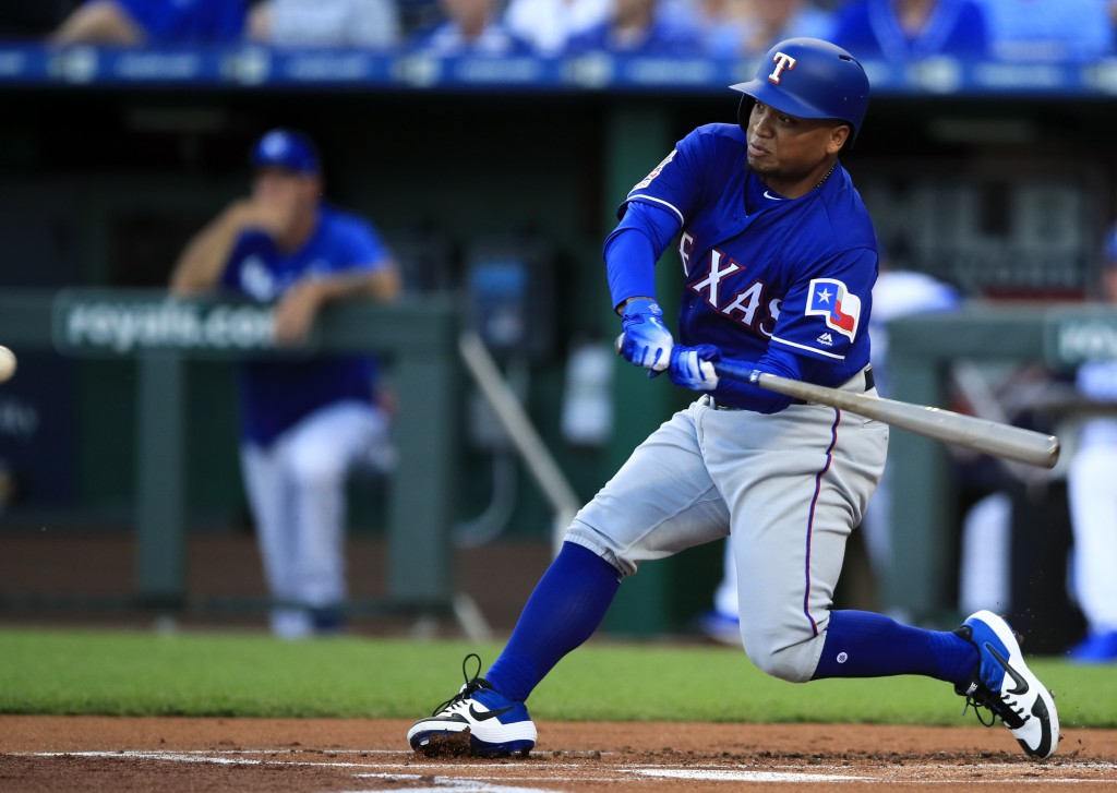 Texas Rangers designated hitter Willie Calhoun hits a two-run home run off Kansas City Royals starting pitcher Jorge Lopez during the first inning of
