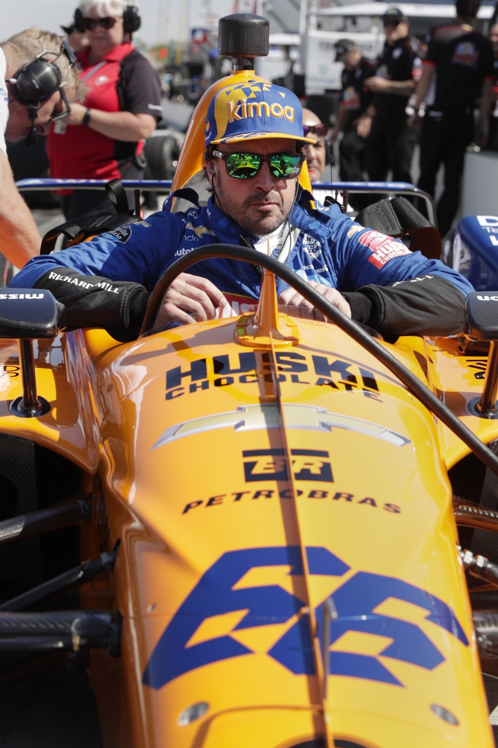 Fernando Alonso, of Spain, climbs into his car during practice for the Indianapolis 500 IndyCar auto race at Indianapolis Motor Speedway, Wednesday, M...