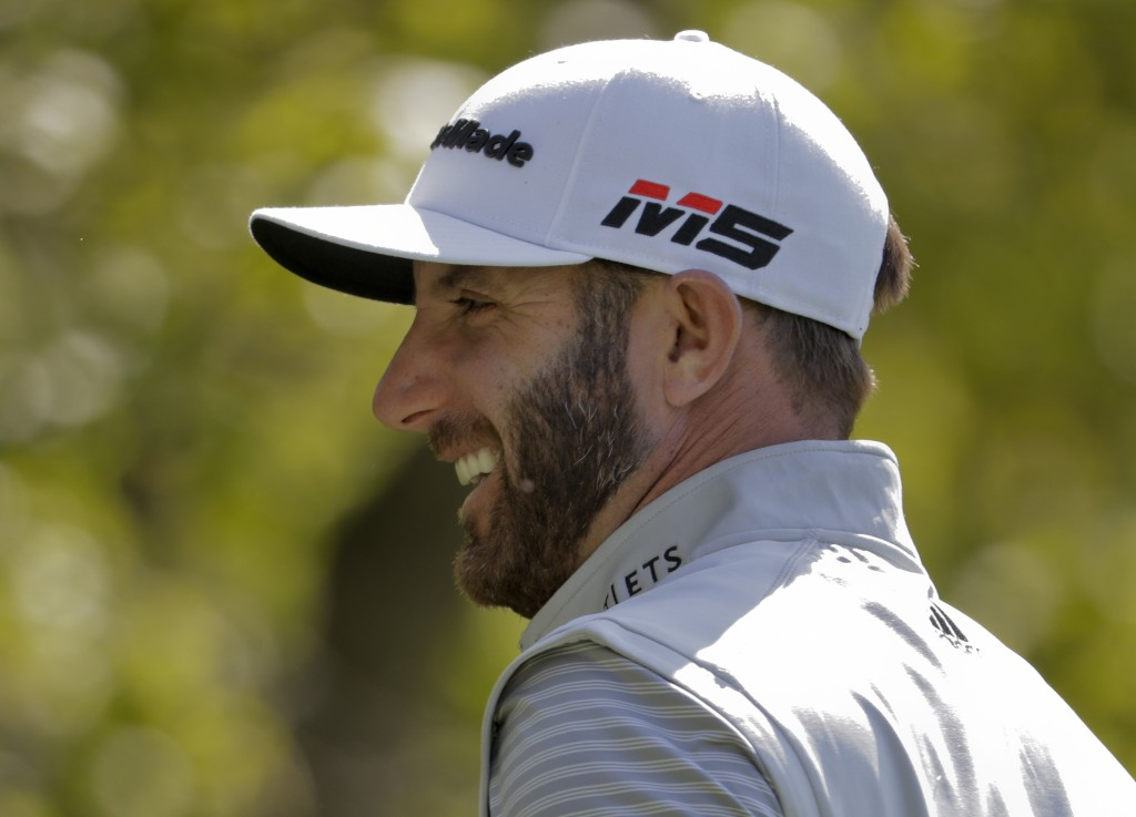 Dustin Johnson reacts before teeing off on the eighth hole during a practice round for the PGA Championship golf tournament, Wednesday, May 15, 2019, ...