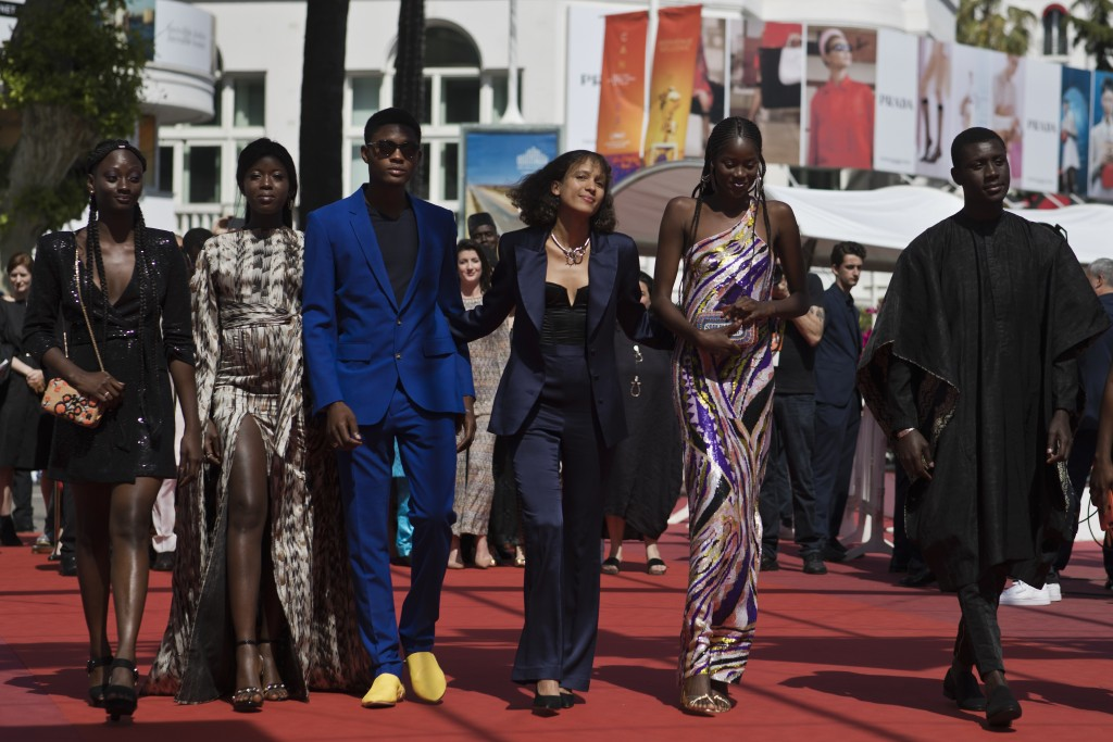 Writer director Mati Diop, fourth from left, poses with cast and crew upon arrival at the premiere of the film 'Atlantique' at the 72nd international