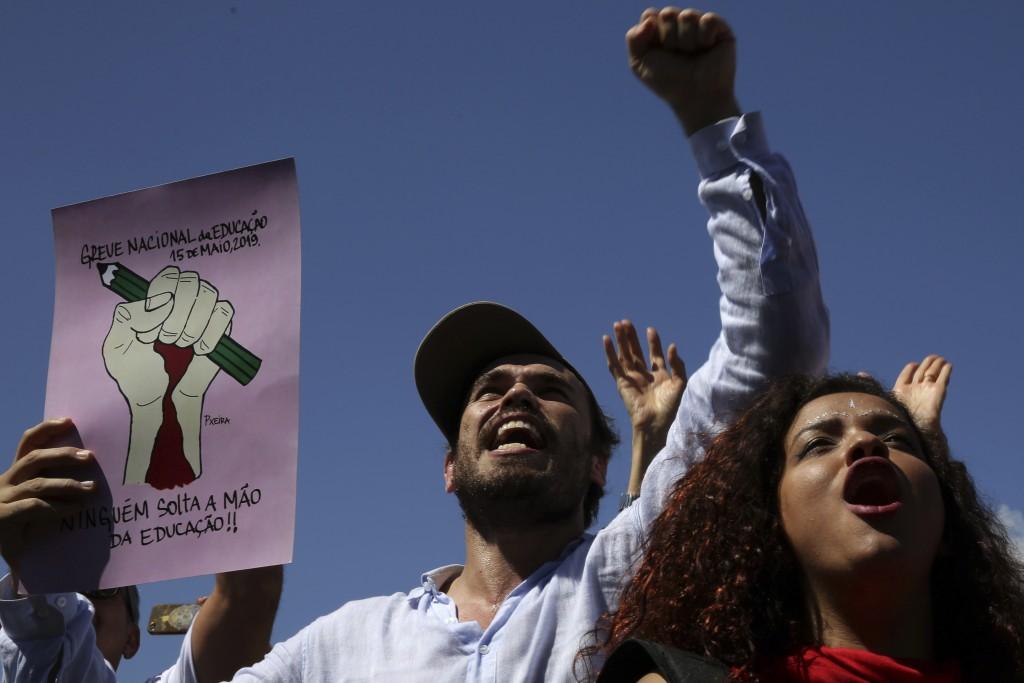 Demonstrators shout slogans against Brazil's President Jair Bolsonaro, during nation-wide education strike, in Brasilia, Brazil, Wednesday, May 15, 20