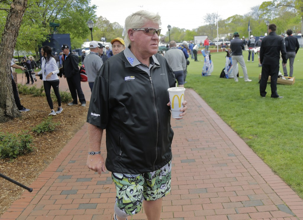 John Daly walks around the putting green before playing a practice round for the PGA Championship golf tournament, Wednesday, May 15, 2019, at Bethpag