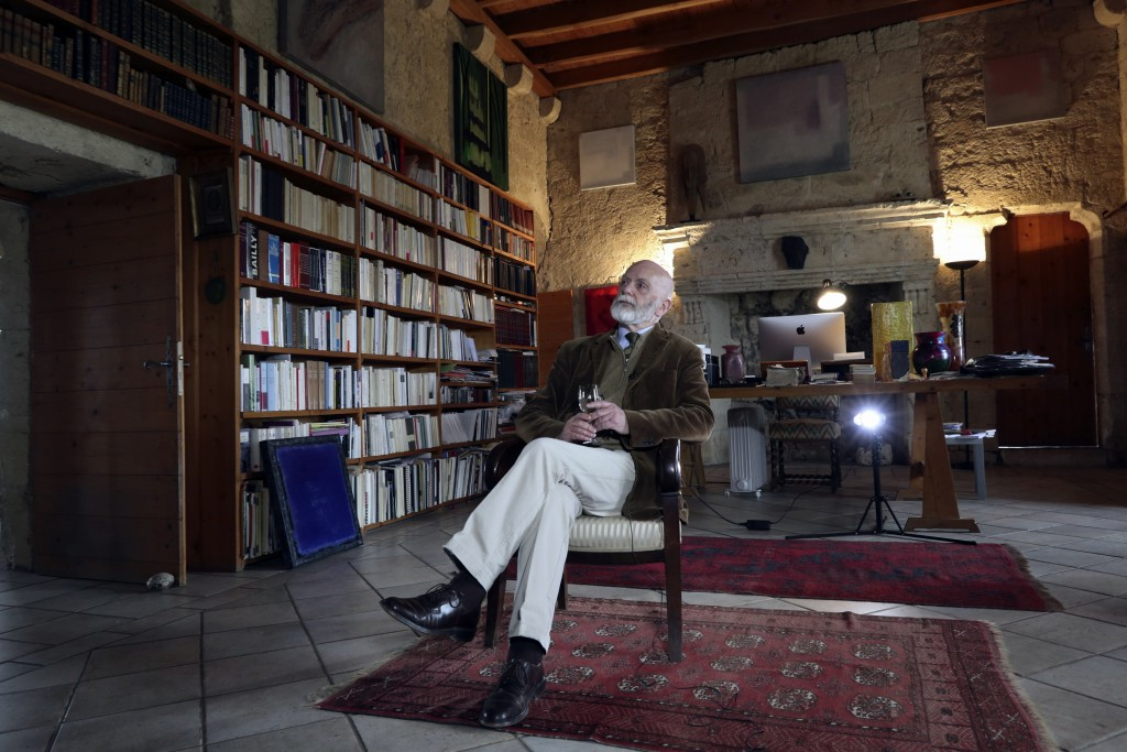 """In this photo taken Thursday, April 4, 2019, a candidate for Europe's legislature Renaud Camus, who coined the term, """"the great replacement,"""" sits in"""