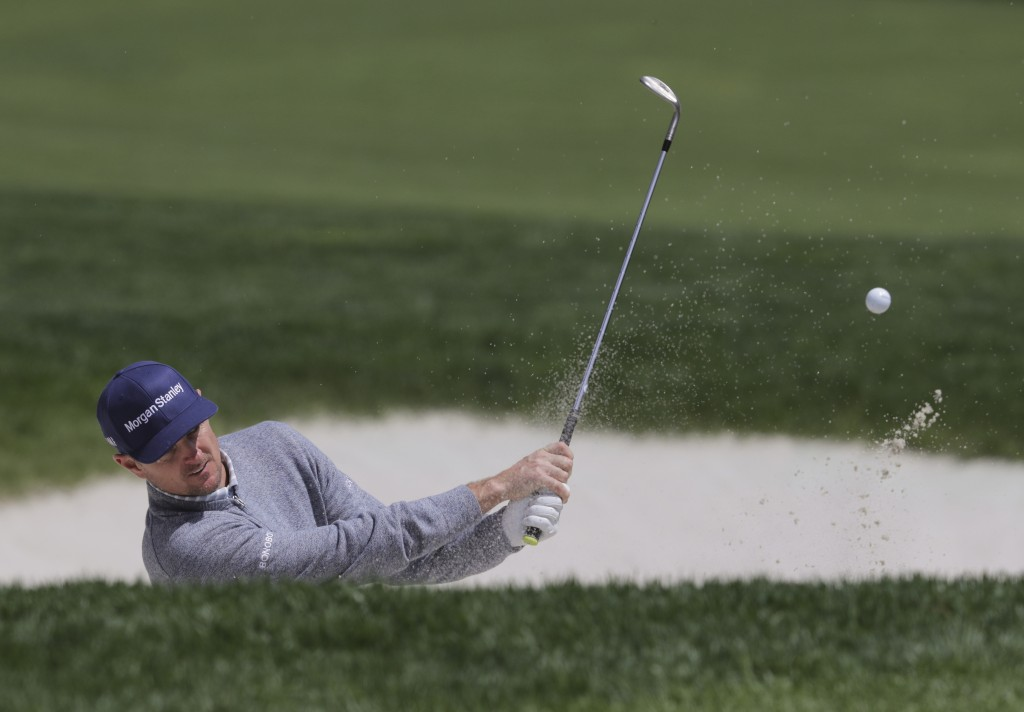Justin Rose, of England, hits out of a bunker on the ninth hole during a practice round for the PGA Championship golf tournament, Wednesday, May 15, 2