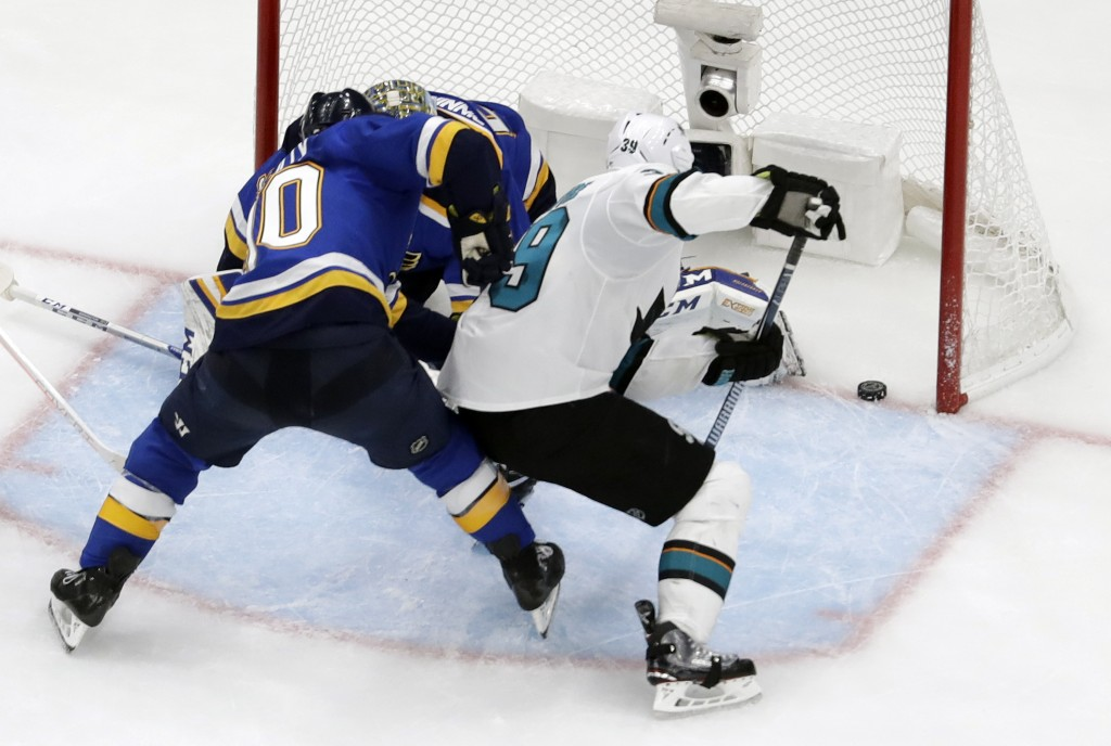 San Jose Sharks center Logan Couture (39) scores the tying goal against St. Louis Blues center Ryan O'Reilly (90) and Jordan Binnington during the thi