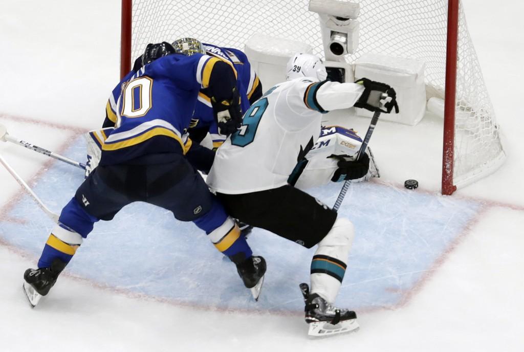 San Jose Sharks center Logan Couture (39) scores the tying goal against St. Louis Blues center Ryan O'Reilly (90) and Jordan Binnington during the thi