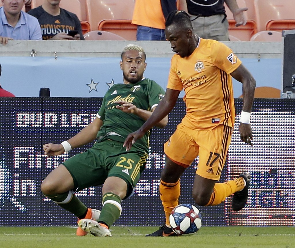 Portland Timbers defender Bill Tuiloma (25) tries to take the ball from Houston Dynamo forward Alberth Elis (17) during the first half of an MLS socce