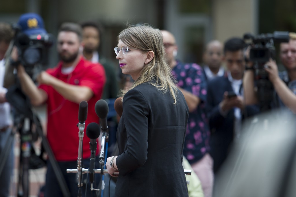 Former Army intelligence analyst Chelsea Manning speaks with reporters, after arriving at the federal courthouse in Alexandria, Va., Thursday, May 16,