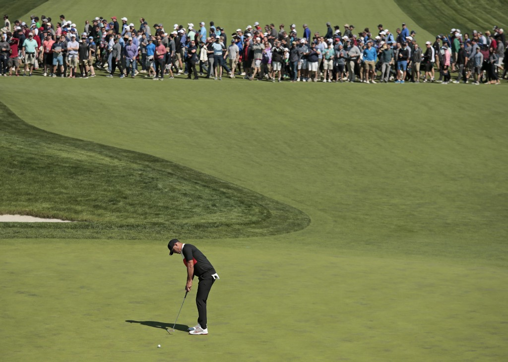 Brooks Koepka putts on the 16th green during the first round of the PGA Championship golf tournament, Thursday, May 16, 2019, at Bethpage Black in Far