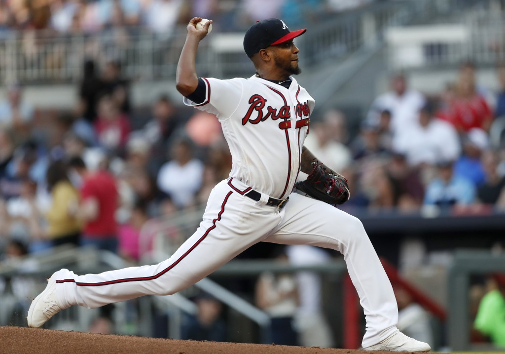 Atlanta Braves starting pitcher Julio Teheran (49) works in the first inning of a baseball game against the St. Louis Cardinals Thursday, May 16, 2019