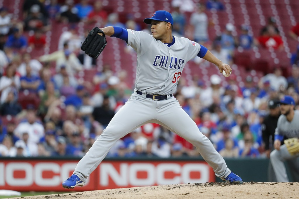 Chicago Cubs starting pitcher Jose Quintana throws during the first inning of the team's baseball game against the Cincinnati Reds on Thursday, May 16