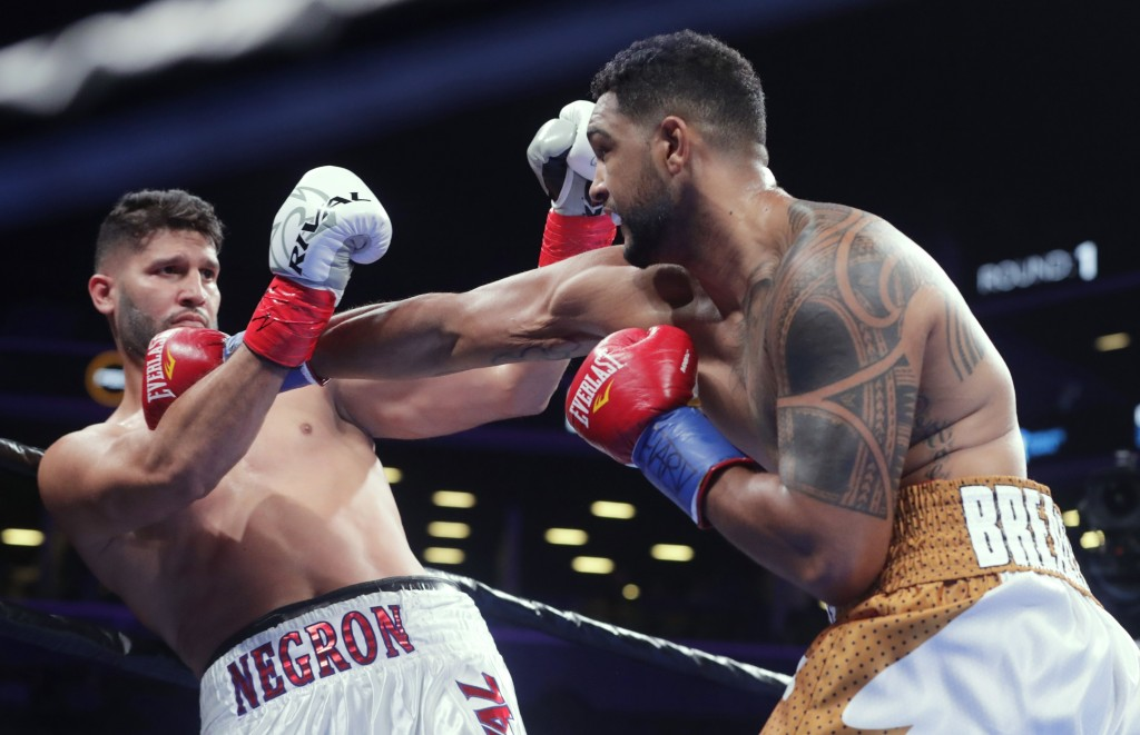 FILE - In this Dec. 22, 2018, file photo, Dominic Breazeale, right, punches Carlos Negron during the first round of a heavyweight boxing match in New