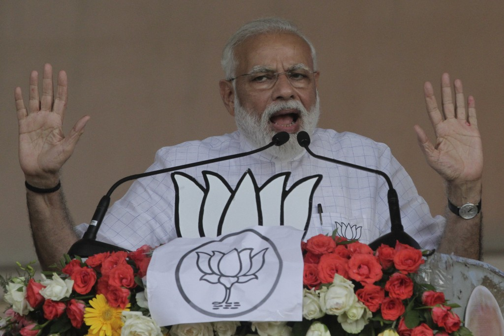 FILE - In this Wednesday, April 3, 2019. file photo, Indian Prime Minister Narendra Modi speaks at an election campaign in Kolkata, capital of the eas