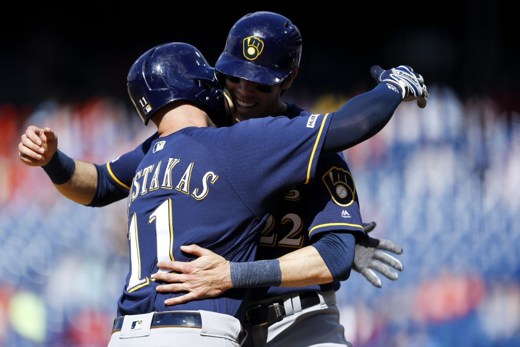 Milwaukee Brewers' Mike Moustakas, left, and Christian Yelich celebrate after Moustakas' two-run home run off Philadelphia Phillies relief pitcher Aus