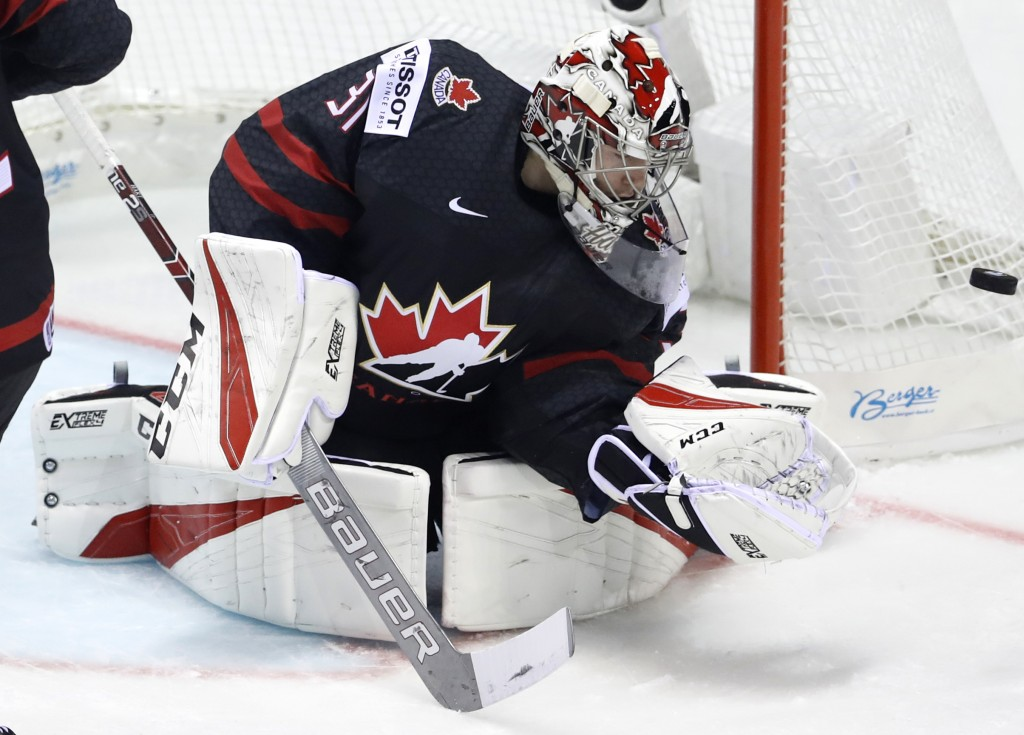 Canada's goaltender Carter Hart makes a save during the Ice Hockey World Championships group A match between Canada and France at the Steel Arena in K...