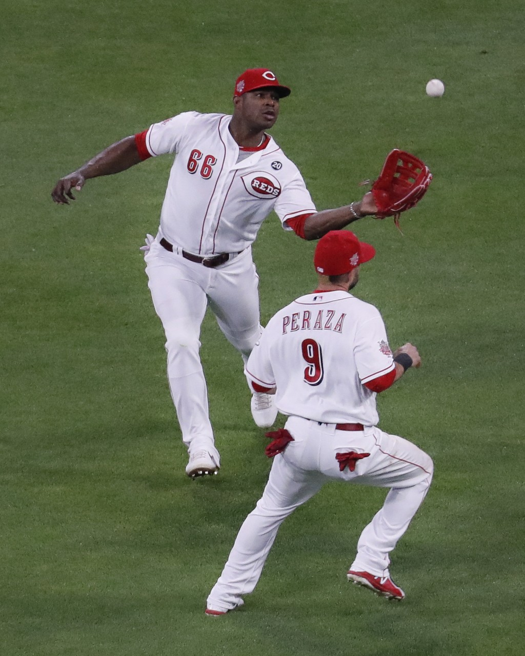 Cincinnati Reds right fielder Yasiel Puig (66) catches a fly ball by Chicago Cubs' Jose Quintana for an out, next to second baseman Jose Peraza during