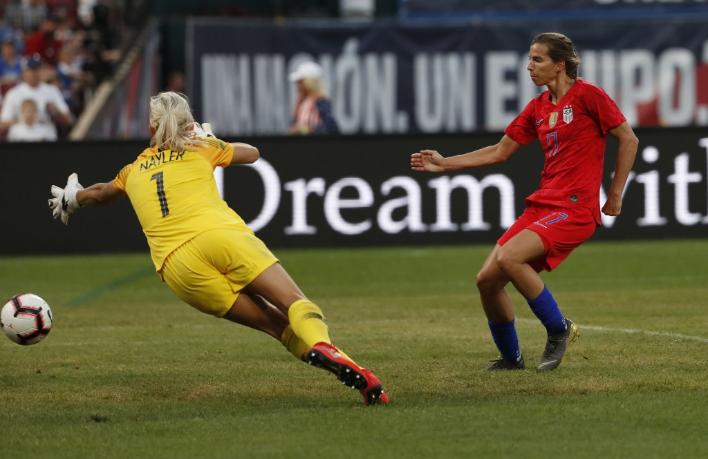 United States forward Tobin Heath, right, scores past New Zealand goalkeeper Erin Nayler during the first half of an international friendly soccer mat