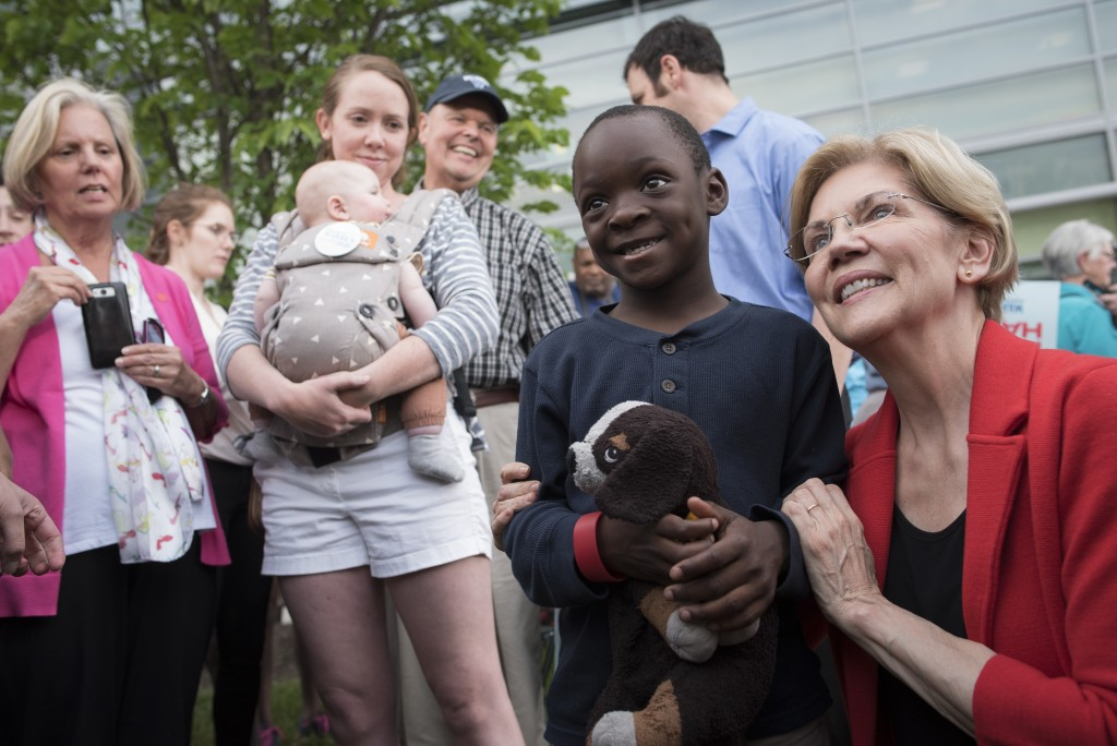 Democratic presidential candidate Sen. Elizabeth Warren, D-Mass., poses for a photo with Duke Okonda, 6, from Fairfax, Va., after addressing a campaig