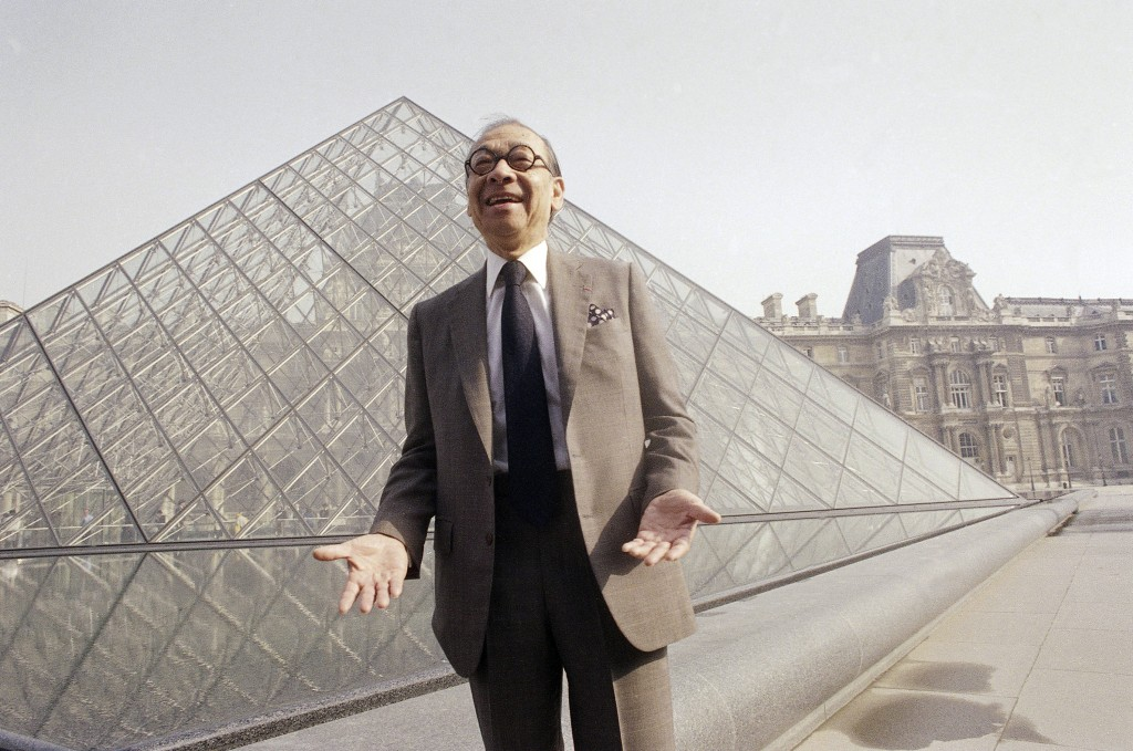 FILE - In this March 29, 1989, file photo, Chinese-American architect I.M. Pei laughs while posing for a portrait in front of the Louvre glass pyramid
