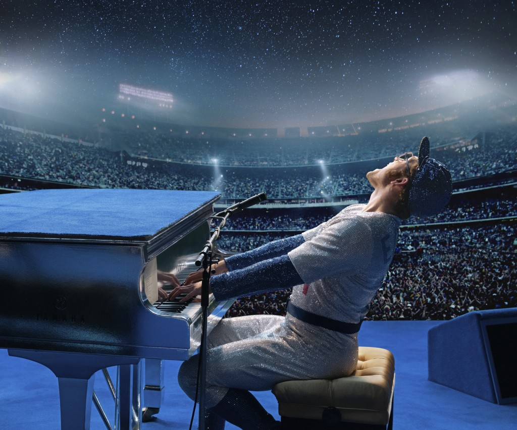 """This image released by Paramount Pictures shows Taron Egerton as Elton John in a scene from """"Rocketman."""" (David Appleby/ Paramount Pictures via AP)"""