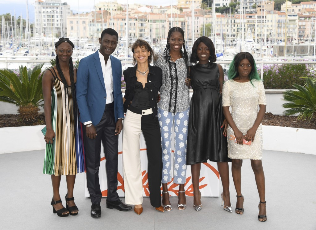 Actors Aminata Kane, from left, Amadou Mbow, director Mati Diop, actors Mame Sane, Nicole Sougou, and Mariama Gassama pose for photographers at the ph
