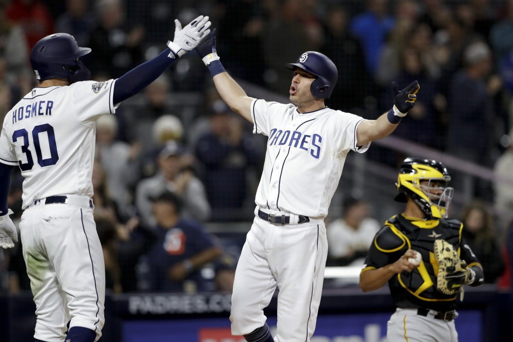 San Diego Padres' Ian Kinsler, center, celebrates with teammate Eric Hosmer (30) after hitting a three-run home run during the sixth inning of the tea